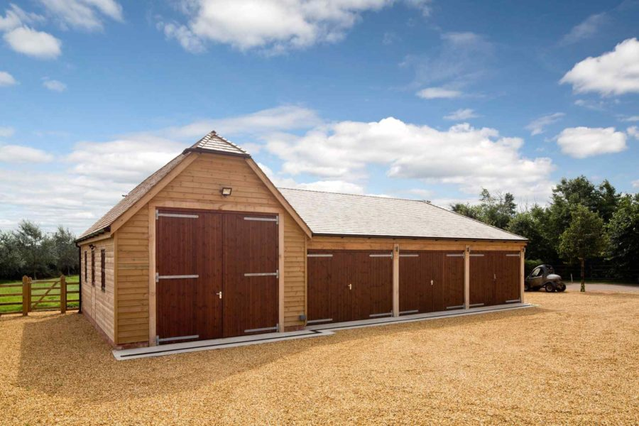 Three bay timber garage with t shape barn rutland for Barn shaped garage